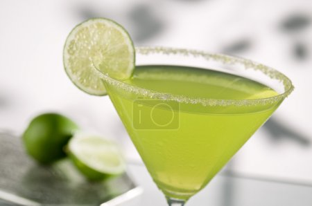 Photo for Margarita drink with lime, focus is on rim of glass, and salt - Royalty Free Image