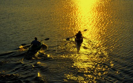 Man and Woman Kayaking at Sunset
