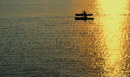 Man and Woman Kayaking at Sunset