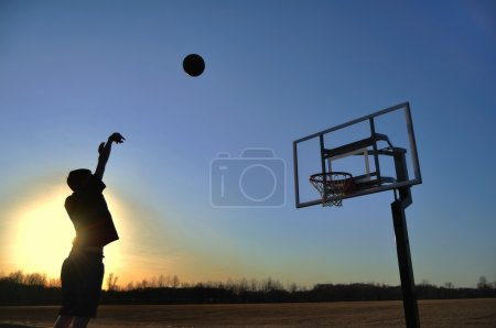 Silhouette of Teen Boy & Basketball