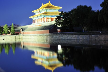 Forbidden city with reflection at night