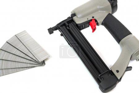 Photo pour Nial commercial gun pour la construction de l'ossature de bois - image libre de droit
