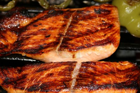 Photo for Marinated and glazed grilled salmon steaks and peppers - Royalty Free Image