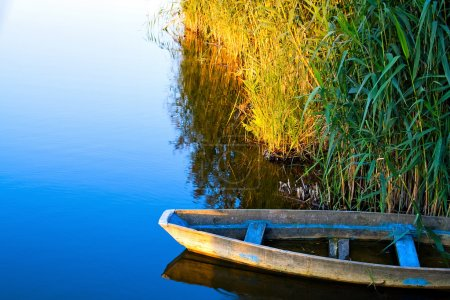 Photo for Lone boat on calm water - Royalty Free Image
