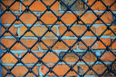 Pattern of iron grid and brickwall