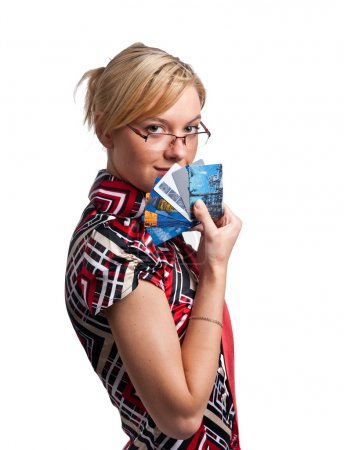 Young cute woman, holding credit cards
