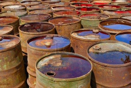 Old rusty toxic barrels