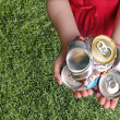 Aluminum Cans Crushed For Recycling in a Childs Ha...