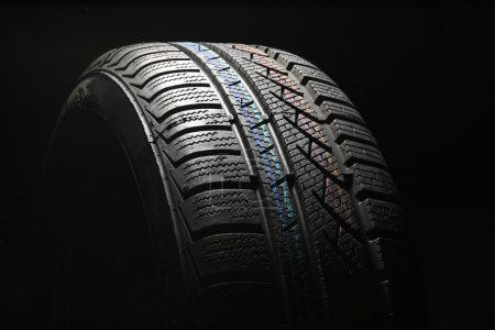Photo for New car tire close up on black background - Royalty Free Image