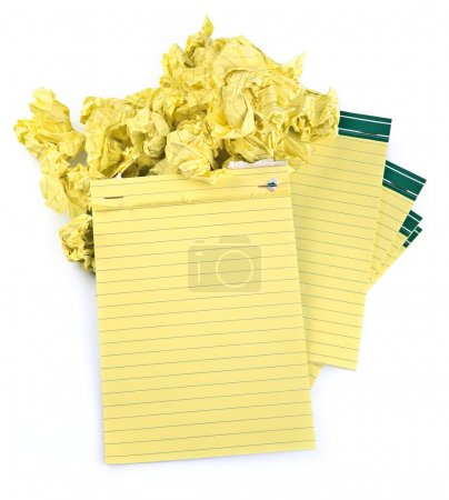 Paper notebooks and crumpled paper