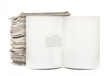 Squared exercise book and magazines