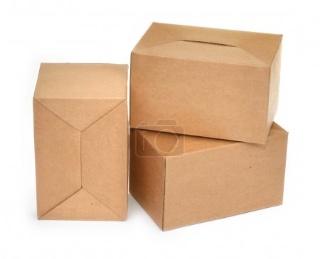 Photo for Close-up of three cardboard boxes againt white background, minimal natural shadow in front - Royalty Free Image