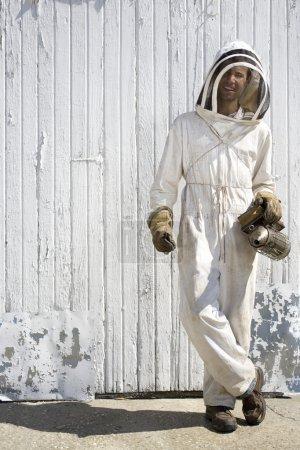 Beekeeper with Crossed Legs