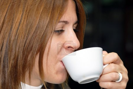 Female enjoying a cup of coffe