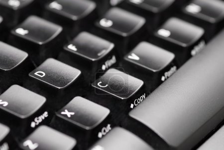 Photo for Closeup image of computer keyboard, focus on letter C and copy text - Royalty Free Image