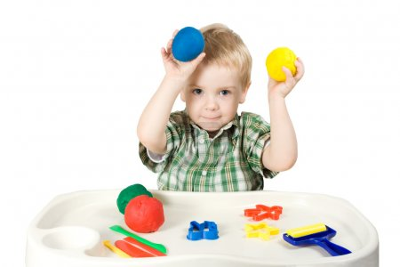 Photo for Happy child playing with plasticine colorful balls - Royalty Free Image