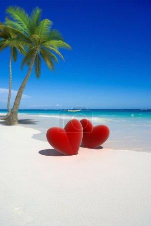 Photo pour Rendu 3D de deux cœurs rouges sur une plage tropicale - image libre de droit