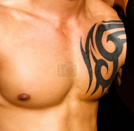 Male torso with tattoo