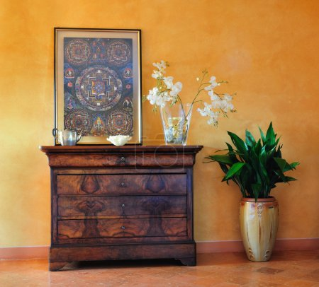 Photo for Vintage dresser and print with plant pot, in a luxury home - Royalty Free Image