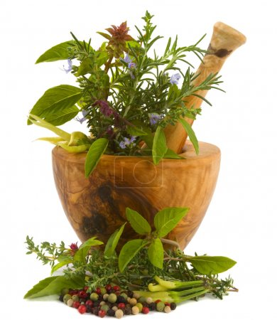 Photo for Healing herbs, spices, and edible flowers (hand carved olive tree mortar and pestle) - Royalty Free Image