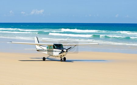 Light Aircraft Taking off on Beach