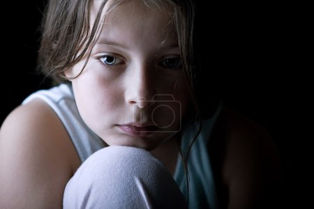Young Child Looking Sad
