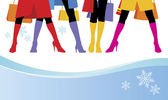 Composition with female feet Standing four women bright boots are put on Near to them snowflakes are located