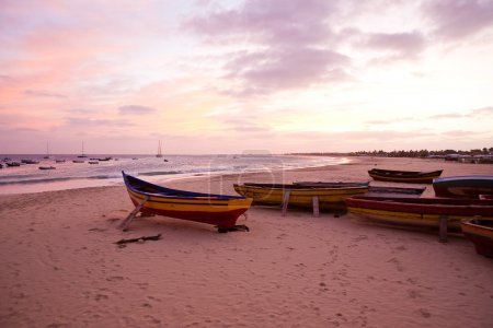 Fishing boats at sunset beach