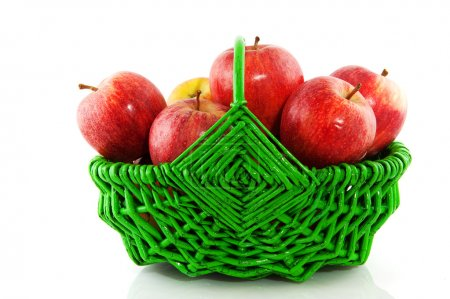 Red apples in green basket