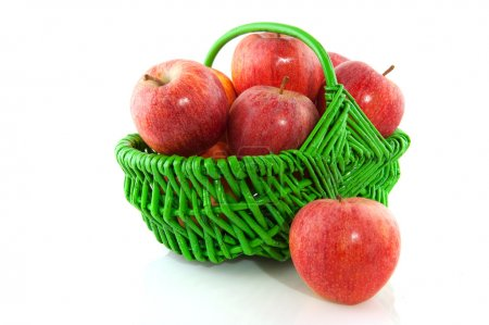 Apples in green basket