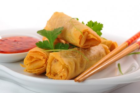 Delicious thai spring rolls with spicy pepper sauc...
