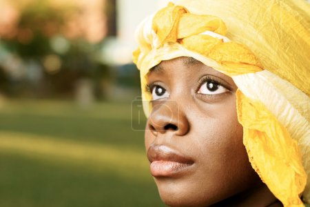 Beautiful woman with golden head scarf w