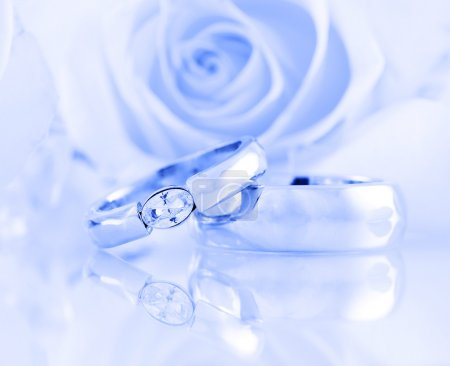 Photo for Wedding still life with beautiful golden rings in blue tone - Royalty Free Image