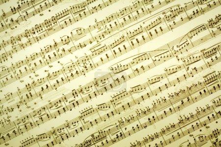Photo pour Fond de notes de musique dans ton brun - image libre de droit