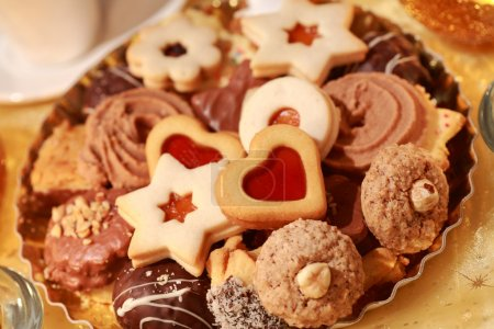 Photo for Detail of delicious Christmas cookies with candles in golden tone - Royalty Free Image
