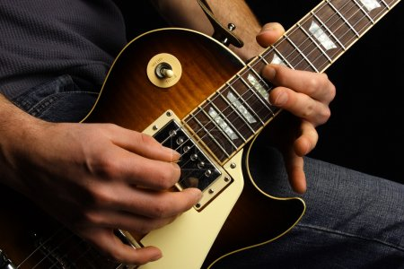 Photo for Close up of an electric guitar being played. - Royalty Free Image