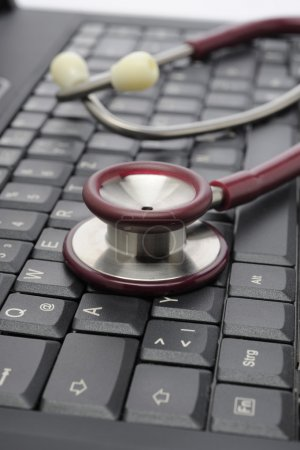 Medicine stethoscope on keyboard