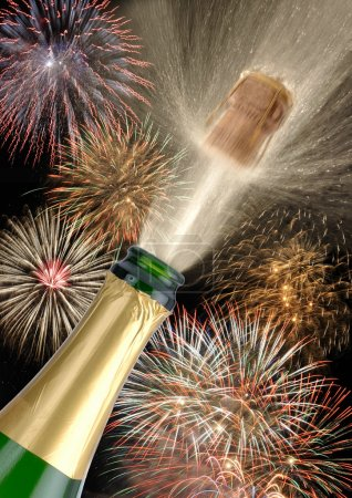 Bottle champagne at new year with fireworks