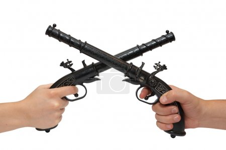Two hands with an old pistol