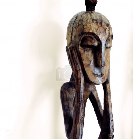 Photo of a african wood carving figurine of two tr...