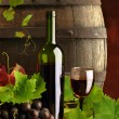 Composition of red wine with grapes, grapevine and old cask