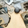 Composition of family memories objects with old photos and letters.