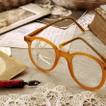Arrangement of old broken glasses, family photogra...