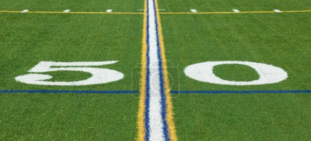 At the 50 yard line on a football field