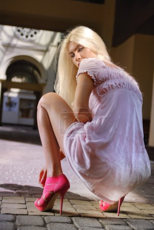 Beautiful girl in pink shoes