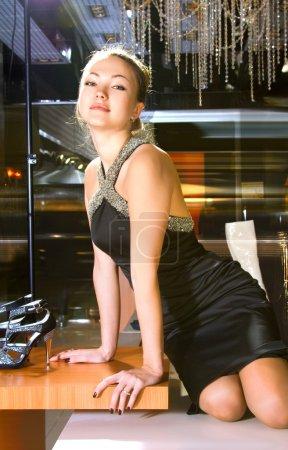 Woman near shop window