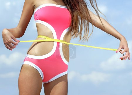 Photo for Woman measuring perfect shape of beautiful thigh healthy lifestyles concept - Royalty Free Image