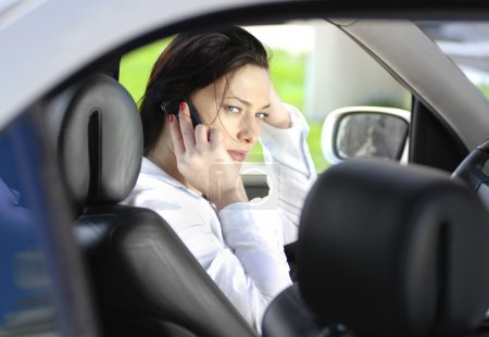 Woman speaks by phone
