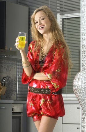 Blonde in modern kitchen with juice