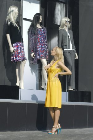 Blonde looks on the show-window